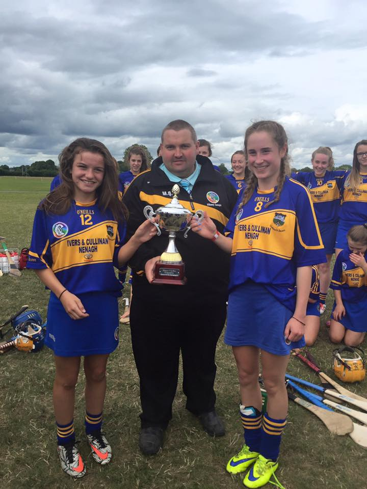 Chairman-Martin-Quilty-presents-the-Intosport.ie-Cup-to-the-tipperary-Team-Joint-Captains